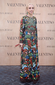 Franca Sozzani sported a vibrant burst of colors in this ornately embroidered Valentino gown during the label's fashion show.