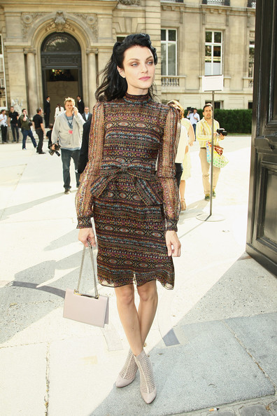 Jessica Stam added some edge to her ladylike frock with a pair of nude mesh ankle boots.