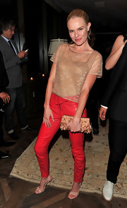 Kate paired her nearly nude lace top with a cool pair of red skinny pants from the pre-fall 2010 collection.