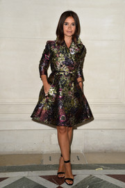 Miroslava Duma donned a swoon-worthy Valentino floral jacquard trenchcoat that featured a charming '50s fit-and-flare silhouette for the label's fashion show.
