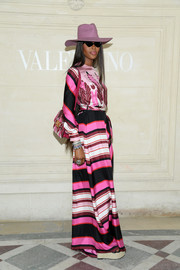Naomi Campbell looked vibrant in a striped, wide-leg jumpsuit by Valentino during the brand's Couture Fall 2019 show.