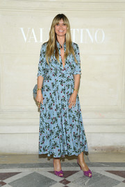 Heidi Klum was spring-chic in a blue floral shirtdress at the Valentino Couture Fall 2019 show.