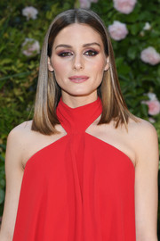 For her eyes, Olivia Palermo paired amethyst shadow with heavy black liner.