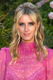 Nicky Hilton looked sweet and glam wearing this teased half-up hairstyle at the Valentino Couture Fall 2018 show.