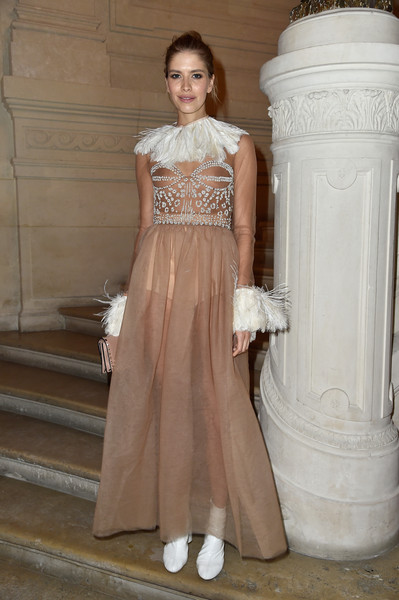 Elena Perminova got all frilled up in a sheer nude Valentino gown, featuring a feathered collar and cuffs and an embellished bodice, for the label's Couture fashion show.