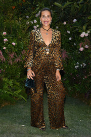 Margherita Missoni donned a patterned gold jumpsuit for the Valentino Couture Fall 2018 show.