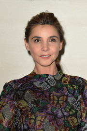 Clotilde Courau wore her hair in a casual ponytail at the Valentino Couture Fall 2014 show.
