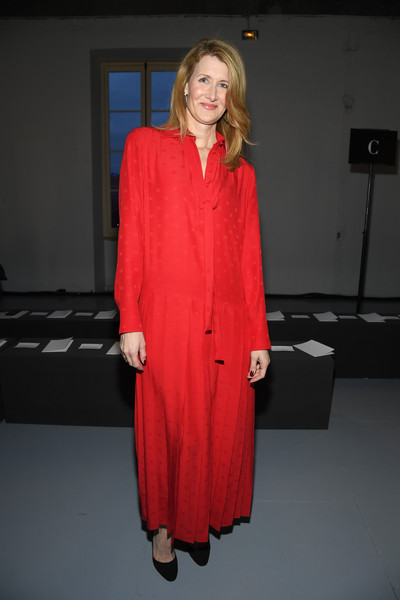 Laura Dern attended the Valentino Menswear Fall 2019 show wearing a red maxi shirtdress.