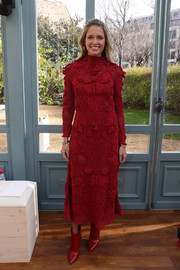 Helena Bordon was winter-chic in an appliqued red sweater dress by Valentino during the label's fashion show.