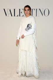 Clotilde Courau layered a white sweater over a fringed gown for the Valentino Fall 2020 show.