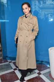 Kristin Scott Thomas arrived for the Valentino fashion show looking stylish in a beige trenchcoat.