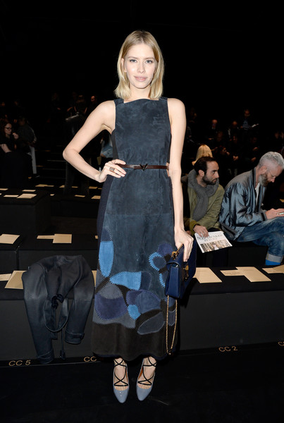 Elena Perminova looked very stylish at the Valentino show in a sleeveless suede dress in various shades of blue, gray, and black.