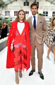 Olivia Palermo topped off her bright ensemble with a military coat from her collection with Banana Republic.