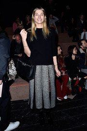 Jessica Hart opted for a casual black sweater when she attended the Valentino fashion show.