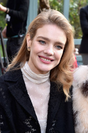 Natalia Vodianova attended the Valentino fashion show wearing her hair in casual curls.