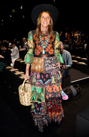 Anna dello Russo donned a bold and vivid mixed-print maxi dress by Valentino for the brand's fashion show.