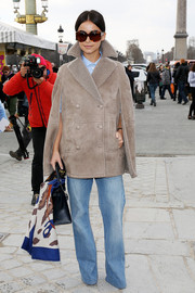 Miroslava Duma looked fiercely stylish in a gray suede jacket during the Valentino fashion show.