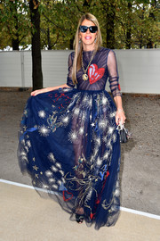 Anna dello Russo went for whimsical glamour in a heart-embroidered blue gown by Valentino when she attended the label's fashion show.