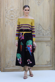 Olivia Palermo was sporty-chic up top in a striped off-the-shoulder sweater by Valentino during the label's Spring 2017 show.