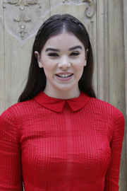Hailee Steinfeld looked sweet and romantic wearing this center-parted crown braid at the Valentino fashion show.