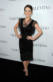 Jessica Stroup wore this lacy black dress to the Valentino store opening on Rodeo drive.
