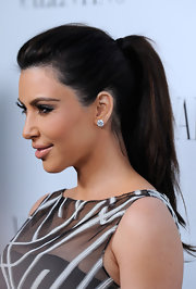 Kim Kardashian attended the opening of the Valentino flagship store on Rodeo Drive wearing her hair in a simple ponytail.