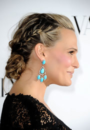 Mom-to-be Molly Sims wore her long locks in an adorable braided updo while attending the opening of the Valentino flagship store in Beverly Hills.