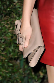 Teresa Palmer carried this darling bow-adorned clutch to the Valentino store opening in Beverly Hills.