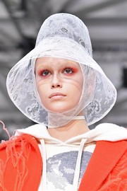 Kaia Gerber walked the Valentino runway wearing a white lace cloche.