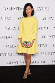 Nicole Warne styled her dress with a colorful beaded clutch, also by Valentino.