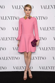 Emma Roberts' purple Valentino Rockstud clutch and pink mini dress were a super-sweet color pairing.