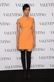 Padma Lakshmi chose a sweet bow-adorned orange mini by Valentino for the Sala Bianca 945 event.