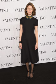 Sticking to her signature minimalist black, Sofia Coppola chose a Valentino dress whose only adornment came from the feathered collar.