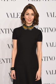 Sofia Coppola paired an embellished cuff with a collared LBD for the Valentino Sala Bianca 945 event.