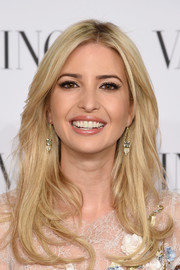 Ivanka Trump styled her locks into a fabulous face-framing center-parted 'do for the Valentino Sala Bianca 945 event.