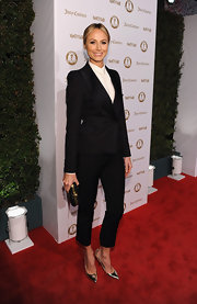 Stacy Keibler kept her figure under wraps for the night in favor of a black suit with cropped pants.