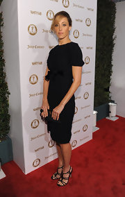 Kim Raver put a sweet spin on the little black dress by choosing a look with short sleeves and a bow embellishment at the Vanities 20th Anniversary Event.