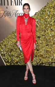 Hilary Rhoda complemented her frock with strappy red heels by Rene Caovilla.
