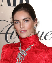 Hilary Rhoda opted for a casual updo when she attended the Vanity Fair 2019 Best Dressed List event.