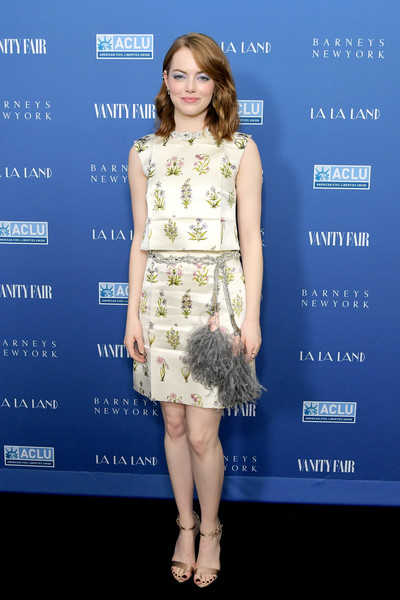 Emma Stone polished off her look with a pair of bronze ankle-strap sandals.