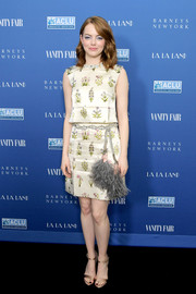 Emma Stone amped up the feminine vibe with a matching mini skirt that was adorned with a bedazzled and feathered belt.