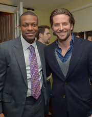 Chris Tucker added some spice to his gray suit with a bright purple geometric tie.