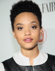 For her beauty look, Kiersey Clemons teamed gray eyeshadow with a subtle berry lip.