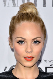 Laura Vandervoort pulled her hair up into a playful top knot for the Vanity Fair Campaign Hollywood kickoff.