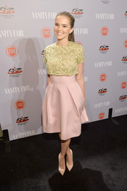 Zoey Deutch charmed at the Young Hollywood celebration in a yellow and pink Dior dress with a lace-overlay bodice.