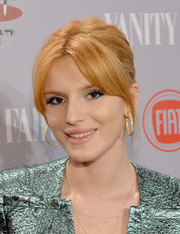 For her beauty look, Bella Thorne didn't scrimp on the colors, sporting sparkly green shadow and blue liner.