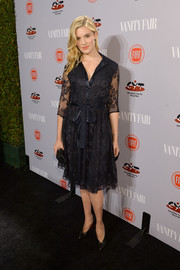 Maggie Grace went the ladylike route in a bowed black lace dress during the Young Hollywood celebration.