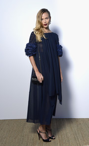 Natasha Poly donned a floaty blue dress with ruffle sleeves for the Vanity Fair and Chanel dinner.