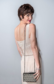 Paz Vega attended the Vanity Fair and Chanel dinner at Cannes carrying an elegant chain-strap box bag.