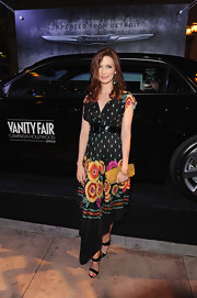 Bitsie Tulloch looked summery in this floral print dress at the Eva Longoria Foundation celebration.